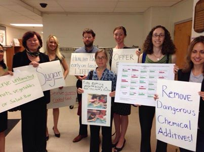 RFKM members holding signs outside BOE Meeting