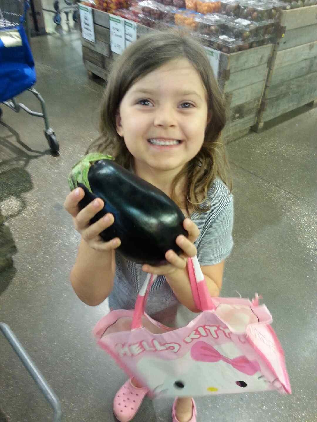 Zoey holding an eggplant