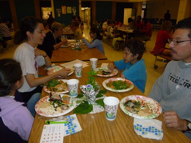Families eating at recipe contest